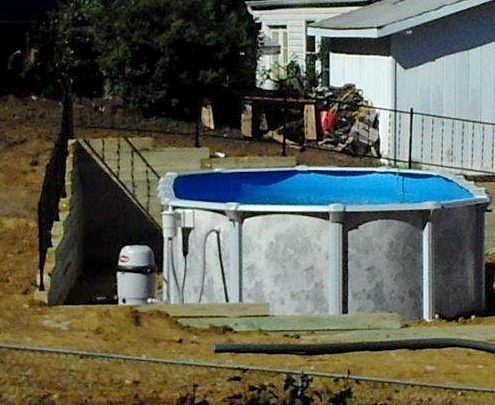 Oval Installation with Retaining Wall