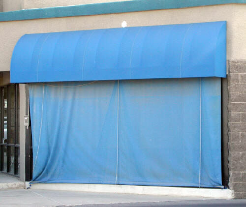 canvas awning and roll up window shade