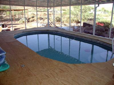 wood deck over pool top rail