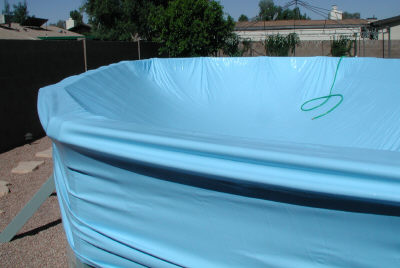 expandable liner pulled over pool rails