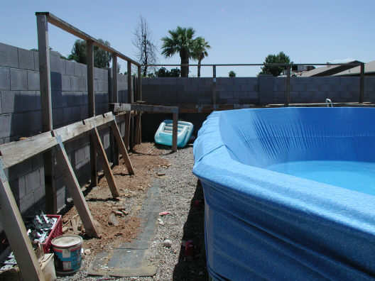 deck removed from above ground pool to install liner