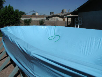 stretching above ground pool liner