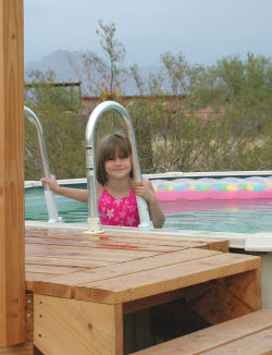 child in an above ground pool