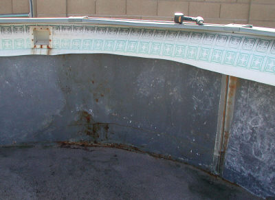 rusted above ground pool wall