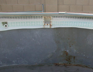 rusted pool skimmer