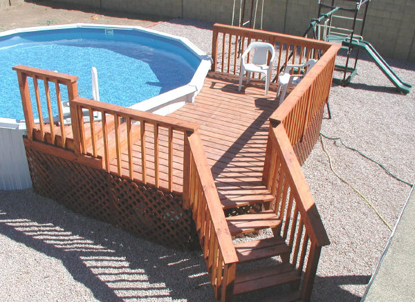 How to build a small above ground pool deck woodguides for Wood deck designs free
