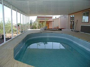 above ground pool and aluminum awning
