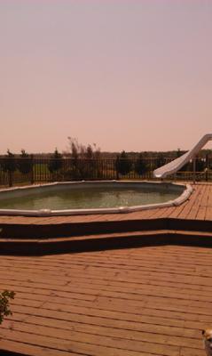 Oval Pool With Decking