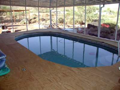 wood deck over pool top rail