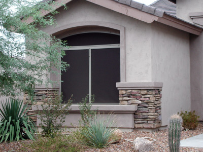 windows on house with screens