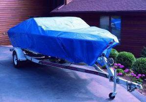blue tarp over boat